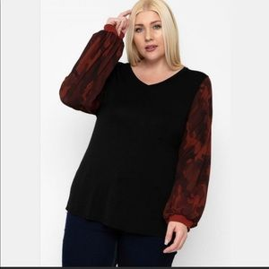 Black v-neck top with camo print bubble sleeves